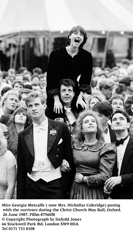 Miss Georgia Metcalfe ( now Mrs. Nichollas Coleridge) posing with the survivors during theChrist Church May Ball, Oxford. 26 June 1987. Fillm 87560f8<br />© Copyright Photograph by Dafydd Jones<br />66 Stockwell Park Rd. London SW9 0DA<br />Tel 0171 733 0108