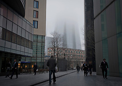 © Licensed to London News Pictures. 01/03/2012. The base of the Shard skyscraper can be seen through the fog. Fog in Central London this morning 2nd March 2012.  Photo credit : Ben Cawthra/LNP