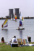 Nuclear Energy: Picnic area and windsurfers enjoy the cooling pond for the Nuclear Power Plant in Rancho Seco, California (1987). Cooling towers on opposite shore..