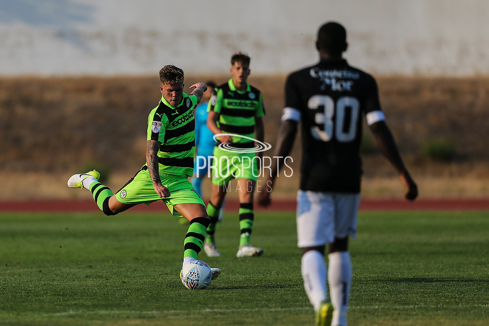 Forest Green Rovers Charlie Cooper(15) passes the ball forward during the Pre-Season Friendly match between SC Farense and Forest Green Rovers at Estadio Municipal de Albufeira, Albufeira, Portugal on 25 July 2017. Photo by Shane Healey.