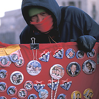 A souvenir vendor bundled against the sub-zero temperatures on the day of President Ronald Reagan's second Inauguration 21 January 1985. Due to the cold, the outdoor ceremony was moved indoors.
