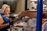 ROME, ITALY - AUGUST 15: A guest takes the food to the Caritas canteen at Colle Oppio in Rome  on the mid-August holiday on August 15, 2017 in Rome, Italy. Caritas canteen of Colle Oppio  provide about 500 meals a day for lunch.