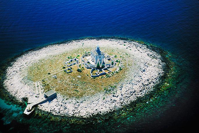Aerial view of lighthouse on island off Dalmatian Coast of Croatia