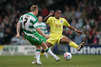 Photo: Lee Earle.<br /> Yeovil Town v Colchester United. Coca Cola League 1. 06/05/2006. Yeovil's Paul Terry (L) clears from Neil Danns.