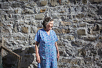 ACCIAROLI (POLLICA), ITALY - 5 OCTOBER 2016: 82-years old Fenisia La Greca poses for a portrait by her garden next to her house in Acciaroli, a hamlet in the municipality of Pollica, Italy, on October 5th 2016. Fenisia La Greca grows fruit and vegetables in her own garden.<br /> <br /> To understand how people can live longer throughout the world, researchers at University of California, San Diego School of Medicine have teamed up with colleagues at University of Rome La Sapienza to study a group of 300 citizens, all over 100 years old, living in Acciaroli (Pollica), a remote Italian village nestled between the ocean and mountains in Cilento, southern Italy.<br /> <br /> About 1-in-60 of the area's inhabitants are older than 90, according to the researchers. Such a concentration rivals that of other so-called blue zones, like Sardinia and Okinawa, which have unusually large percentages of very old people. In the 2010 census, about 1-in-163 Americans were 90 or older.