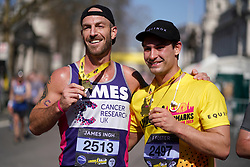 James Ingh and Frankie Foster pose with medals after the 2019 London Landmarks Half Marathon.