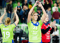 Andrea Penezic #23 of RK Krim Mercator and Misa Marincek #16 of RK Krim Mercator celebrate after the handball match between RK Krim Mercator (SLO) and HC Leipzig (GER) in 6th Round of Women's Champions League on November 16, 2013 in Arena Stozice, Ljubljana, Slovenia.  Photo by Vid Ponikvar / Sportida