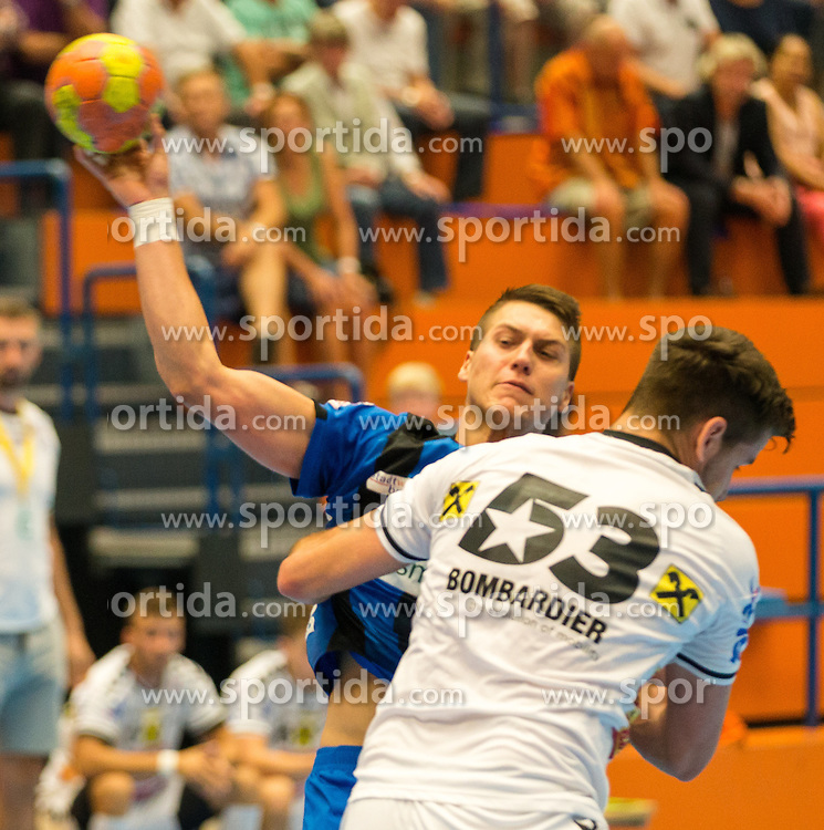 10.09.2016, Sporthalle Bruck an der Mur, Bruck an der Mur, AUT, HLA, HC Bruck vs HC Fivers WAT Margareten, im Bild Mladan Jovanovic (Bruck), Seidl (Fivers) // during the Handball League Austria match between HC Bruck vs HC Fivers WAT Margareten at the sport Hall, Bruck an der Mur, Austria on 2016/09/10, EXPA Pictures © 2016, PhotoCredit: EXPA/ Dominik Angerer