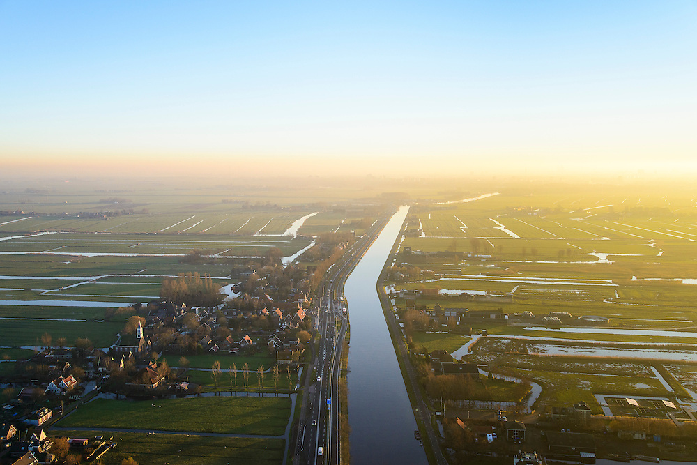 Nederland, Noord-Holland, Monnickendam, 11-12-2013; Waterland ter hoogte van Watergang met Noordhollands Kanaal bij ondergaande zon.<br /> Waterland witk North Holland Canal, north of Amsterdam, with winter sunset.<br /> luchtfoto (toeslag op standaard tarieven);<br /> aerial photo (additional fee required);<br /> copyright foto/photo Siebe Swart.