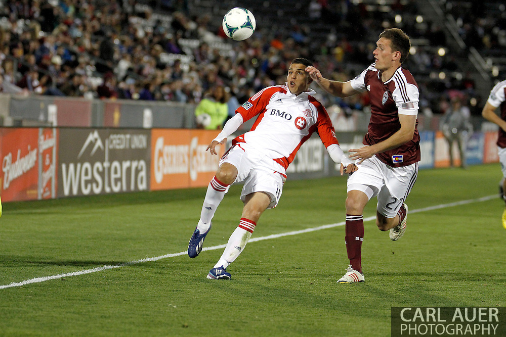 May 4th, 2013 Commerce City, CO - Toronto FC midfielder Luis Silva (11) and Colorado Rapids midfielder Shane O'Neill (27) fight for the ball in the second half of action in the MLS match between the Toronto FC and the Colorado Rapids at Dick's Sporting Goods Park in Commerce City, CO