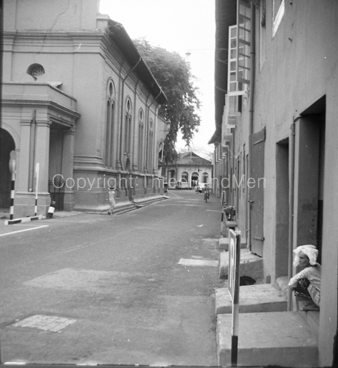 Ronald Lewcock. <br /> Christ Church, and VOC warehouses on right. Malacca.