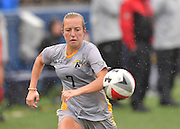 Golden Flashes women's soccer player Jaime Eiben, a junior, runs through the raindrops as she hustles for the ball in a recent match Vs. Miami.