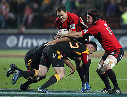 Crusaders' Israel Dagg is tackled by Chiefs' Brendon Leonard in a Super Rugby match, Waikato Stadium, Hamilton, New Zealand, Friday, July 06, 2012.  Credit:SNPA / David Rowland