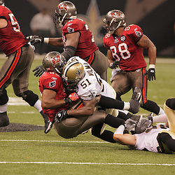2008 September 7: New Orleans Saints linebacker Jonathan Vilma (51) tackles Tampa Bay Buccaneers FB B.J. Askew (35) during their game at the Louisiana Superdome in New Orleans, LA.