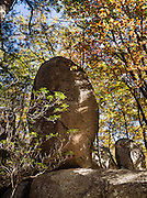 Indian Rocks, fall foliage color in mid October. Walk 0.3 miles to the impressive boulders of Indian Rocks from Indian Gap Parking Area (Milepost 47.5, elevation 2098 feet) on Blue Ridge Parkway, in Virginia, in the Blue Ridge Mountains (a subset of the Appalachian Mountains), USA. The scenic 469-mile Blue Ridge Parkway was built 1935-1987 to aesthetically connect Shenandoah National Park (in Virginia) with Great Smoky Mountains National Park in North Carolina, following crestlines and the Appalachian Trail. (I digitally removed human graffiti from the rock.)