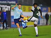 Callum Johnson (2) of Accrington Stanley is tackled by Ashley Smith-Brown (23) of Plymouth Argyle during the EFL Sky Bet League 1 match between Plymouth Argyle and Accrington Stanley at Home Park, Plymouth, England on 22 December 2018.