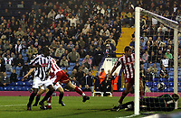 Photo: Mark Stephenson.<br /> West Bromwich Albion v Stoke City. Coca Cola Championship. 03/10/2007.West Brom's  Leon Barnett (L) heads the ball in for 1-1