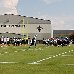 August 6, 2011; Metairie, LA, USA; New Orleans Saints players run team drills during training camp practice at the New Orleans Saints practice facility. Mandatory Credit: Derick E. Hingle