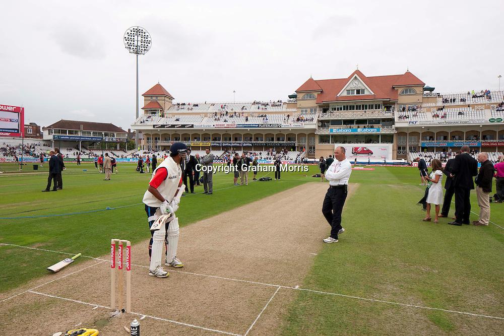Rahul Dravid warms up watched by fourth umpire Tim Robinson before the second npower Test Match between England and India at Trent Bridge, Nottingham.  Photo: Graham Morris (Tel: +44(0)20 8969 4192 Email: sales@cricketpix.com) 29/07/11