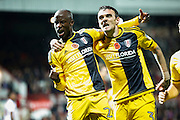 Sone Aluko celebrates after scoring Fulhams first goal in the first half with Scott Malone during the EFL Sky Bet Championship match between Brentford and Fulham at Griffin Park, London, England on 4 November 2016. Photo by Jarrod Moore.