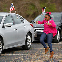 Thomas Wells   BUY AT PHOTOS.DJOURNAL.COM<br /> Mahari Atkinson, 6, skips to her car as the motocade prepares to leave for Monday's Dr. Martin Luther King service that was held at St. Paul Christian Life Center.