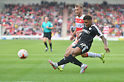 Kadeem Harris of Barnsley FC crosses the ball during the Sky Bet League 1 match between Doncaster Rovers and Barnsley at the Keepmoat Stadium, Doncaster, England on 3 October 2015. Photo by Ian Lyall.