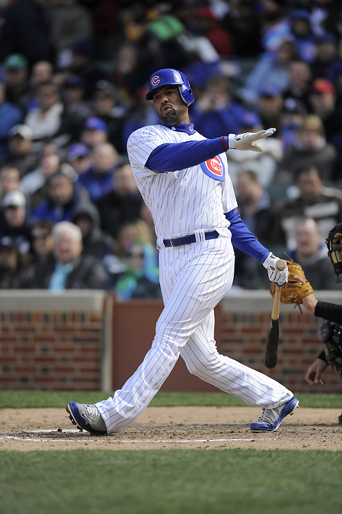 CHICAGO - APRIL 15:  Derrek Lee #25 of the Chicago Cubs bats against the Colorado Rockies on April 15, 2009 at Wrigley Field in Chicago, Illinois.  All players wore number 42 on this day only in honor of Jackie Robinson.  The Rockies defeated the Cubs 5-2.  (Photo by Ron Vesely)