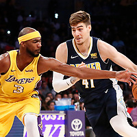 02 October 2017: Denver Nuggets forward Juan Hernangomez (41) drives past Los Angeles Lakers guard Corey Brewer (3) during the Denver Nuggets 113-107 victory over the LA Lakers, at the Staples Center, Los Angeles, California, USA.