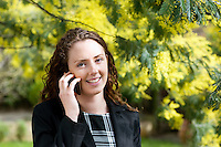 Close-up of young woman talking on cell phone