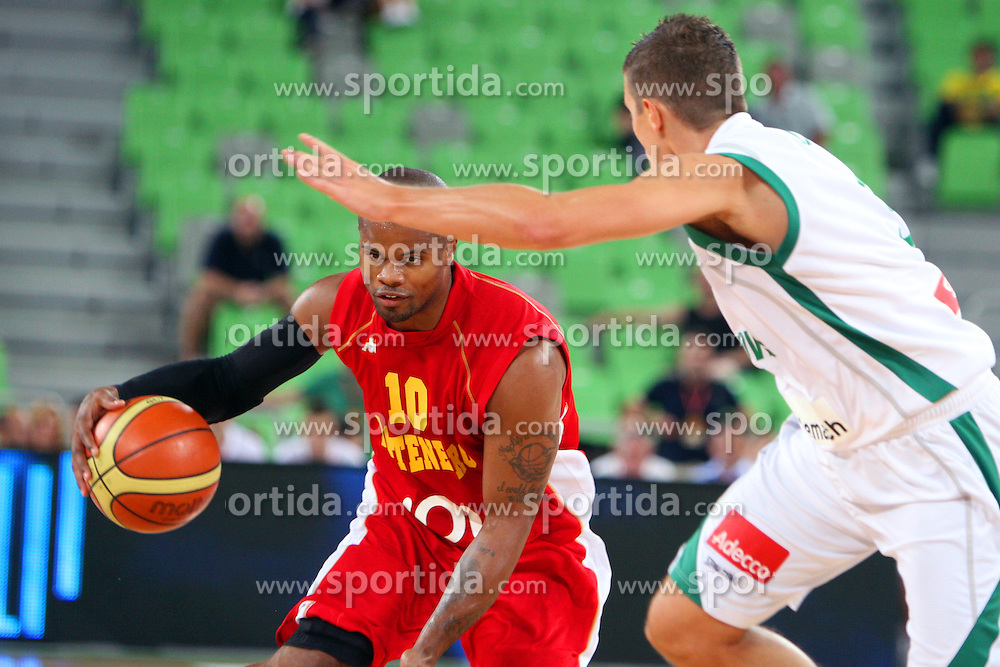 Omar Cook of Montenegro and Jaka Lakovic of Slovenia at friendly match between Slovenia and Montenegro for Adecco Cup 2011 as part of exhibition games before European Championship Lithuania on August 7, 2011, in SRC Stozice, Ljubljana, Slovenia. (Photo by Urban Urbanc / Sportida)