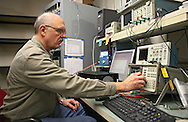 Systems Engineer Ken Bodensteiner works at the final testing station at Softronics LTD in Marion on Monday, February 11, 2013.