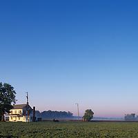 USA, Maryland, Old farmhouse lit by the morning sun near Church Creek along Eastern Shore