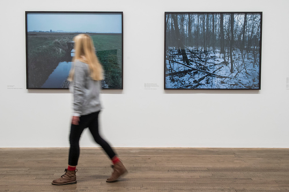 Chloe Dewe Mathews's landscapes of places where British soldiers were executed for desertion. Conflict, Time, Photography, a new exhibition at the Tate Modern - showcasing the unique ways photographers look back at moments of conflict, from the seconds after a bomb is detonated to 100 years after a war has ended. It includes: renowned photographers Don McCullin, Kikuji Kawada and Taryn Simon; Luc Delahaye's large-scale image of the US bombing of Taliban positions in Afghanistan, showing a cloud of smoke rising from the battlefield; Hiromi Tsuchida's large-scale photograph of a watch stopped at the moment the atomic bomb fell on Hiroshima in 1945; The Archive of Modern Conflict's colourful and chaotic new installation, bringing together war-related images and objects from around the world and across the past 100 years; and Chloe Dewe Mathews's haunting landscapes photographed at dawn, showing the places where British soldiers were executed for desertion and cowardice in the First World War. The show runs from 26 November 2014 – 15 March 2015. Tate Modern, London, UK 25 Nov 2014.