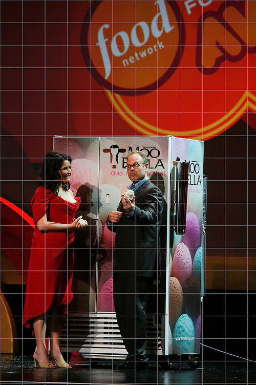 Nigella Lawson and Alton Brown demonstrate the Moo Bella at the First Food Network Awards Show at the Jackie Gleason Theater  of the Performing Arts, in Miami, FL on  Feb 23, 2007.  (Photo/Lance Cheung)  <br /> <br /> PHOTO COPYRIGHT 2007 LANCE CHEUNG<br /> This photograph is NOT within the public domain.<br /> This photograph is not to be downloaded, stored, manipulated, printed or distributed with out the written permission from the photographer. <br /> This photograph is protected under domestic and international laws.