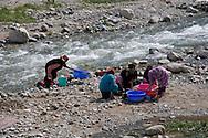 Local women washing clothes in the river in Setti Fatma, Morocco