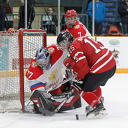 TRENTON, - Dec 10, 2015 -  Exhibition Game 3-  Russia vs Team Canada West at the 2015 World Junior A Challenge at the Duncan Memorial Gardens, ON. Vladislav Sukhachev #77 of Team Russia and Blake Hayward #15 of Team Canada West battle for the puck during the first period (Photo: Amy Deroche / OJHL Images)