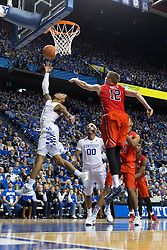 Kentucky guard Tyler Ulis, left, drives to the basket for two of his 20 points in the game. The University of Kentucky hosted Ole Miss, Saturday, Jan. 02, 2016 at Rupp Arena in Lexington.