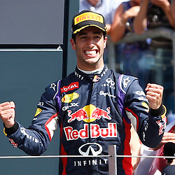 FORMULA 1 SANTANDER BRITISH GRAND PRIX .. Daniel Ricciardo celebrates his third place in the British GP...(c) STEPHEN LAWSON | SportPix.org.uk