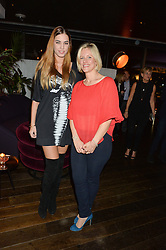 Left to right, AMBER LE BON and BEC ASTLEY CLARKE at a party to celebrate the Astley Clarke & Theirworld Charitable Partnership held at Mondrian London, Upper Ground, London on 10th March 2015.