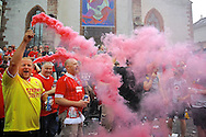 A Liverpool fan holds up a smoke flare as Liverpool fans enjoy the atmosphere in a city square in Basel pictured ahead of the UEFA Europa League Final at St. Jakob-Park, Basel<br /> Picture by Kristian Kane/Focus Images Ltd 07814482222<br /> 18/05/2016