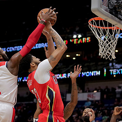 Nov 28, 2018; New Orleans, LA, USA; Washington Wizards guard John Wall (2) blocks a shot by New Orleans Pelicans forward Anthony Davis (23) during the second half at the Smoothie King Center. Mandatory Credit: Derick E. Hingle-USA TODAY Sports