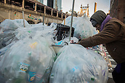 "25 November 2013 - New York, NY [Austin ""Guy"" Butler pushes his cart up First Avenue towards a truck that will buy his haul.] 11/25/13 Stoneham/CUNY Journalism Photo"