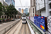 Historic double decker trams passes Statue Square and the Hong Kong Shanghai Bank building in the central district of Hong Kong.