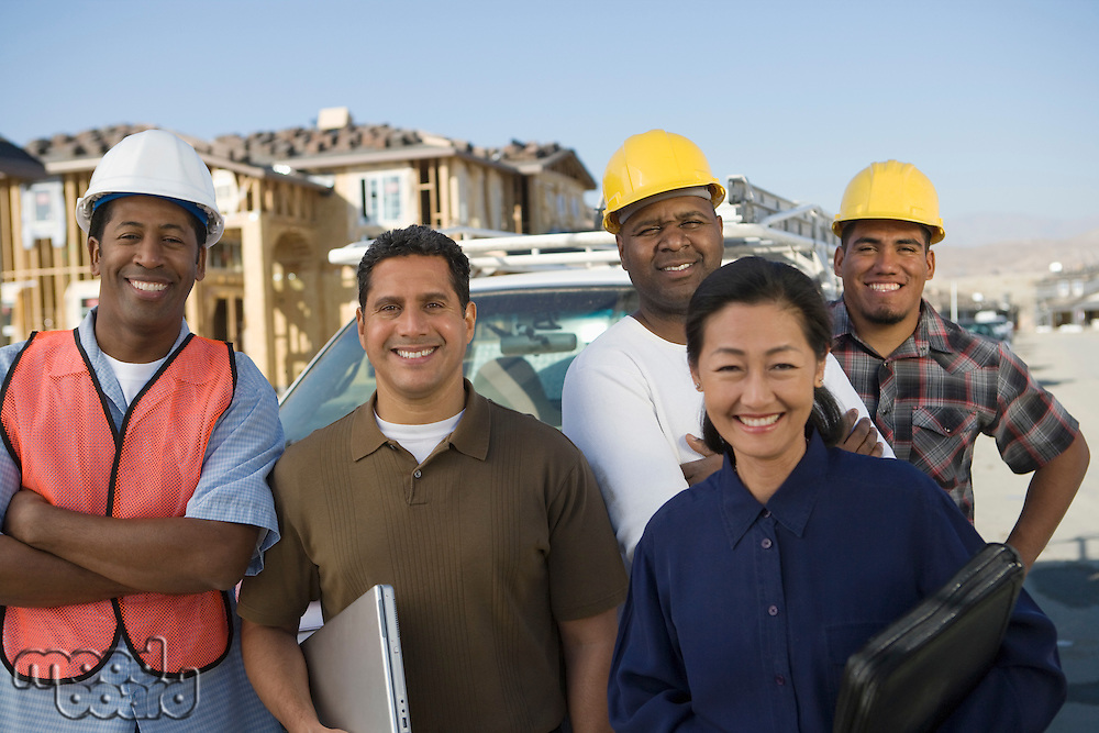 Architects and construction workers on construction site