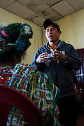 A representative of the  Guatemalan human rights group CALDH, responds to questions from AJR members on developments with the legal process following recent arrests in the genocide cases. Nebaq, El Quiche, Guatemala, October 2011.