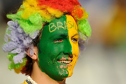 A Brazil fan with a painted face