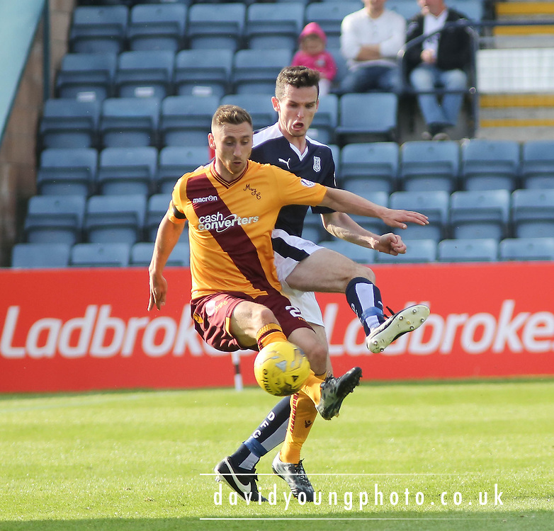 Motherwell&rsquo;s Louis Moult and Dundee&rsquo;s Paul McGinn - Dundee v Motherwell - Ladbrokes Premiership at Dens Park<br /> <br /> <br />  - &copy; David Young - www.davidyoungphoto.co.uk - email: davidyoungphoto@gmail.com