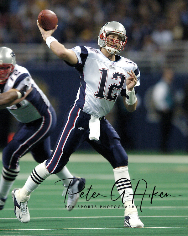 Patriots quarterback Tom Brady (12) gets ready to throw the ball down field against the St. Louis Rams, at the Edward Jones Dome in St. Louis, Missouri, November 7, 2004.