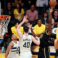 30 March 2018: Los Angeles Lakers forward Julius Randle (30) goes for the floater shot over Milwaukee Bucks center Marshall Plumlee (40) during the Milwaukee Bucks 124-122 victory over the LA Lakers, at the Staples Center, Los Angeles, California, USA.