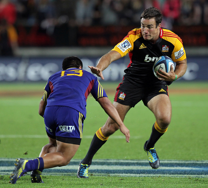 Chiefs' Richard Kahui is challenged by Highlanders' Jason Emery in a Super Rugby match, Waikato Stadium, Hamilton, New Zealand, Friday, March 22, 2013.  Credit:SNPA / David Rowland